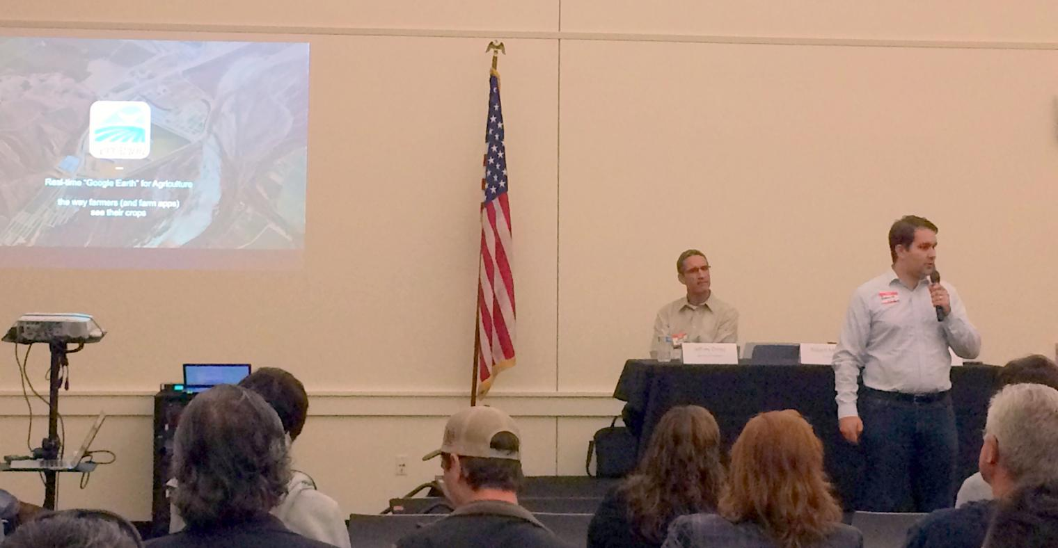 Robert Morris from TerrAvion speaking, Jeffrey Orrey from GeoVisual Analytics on panel