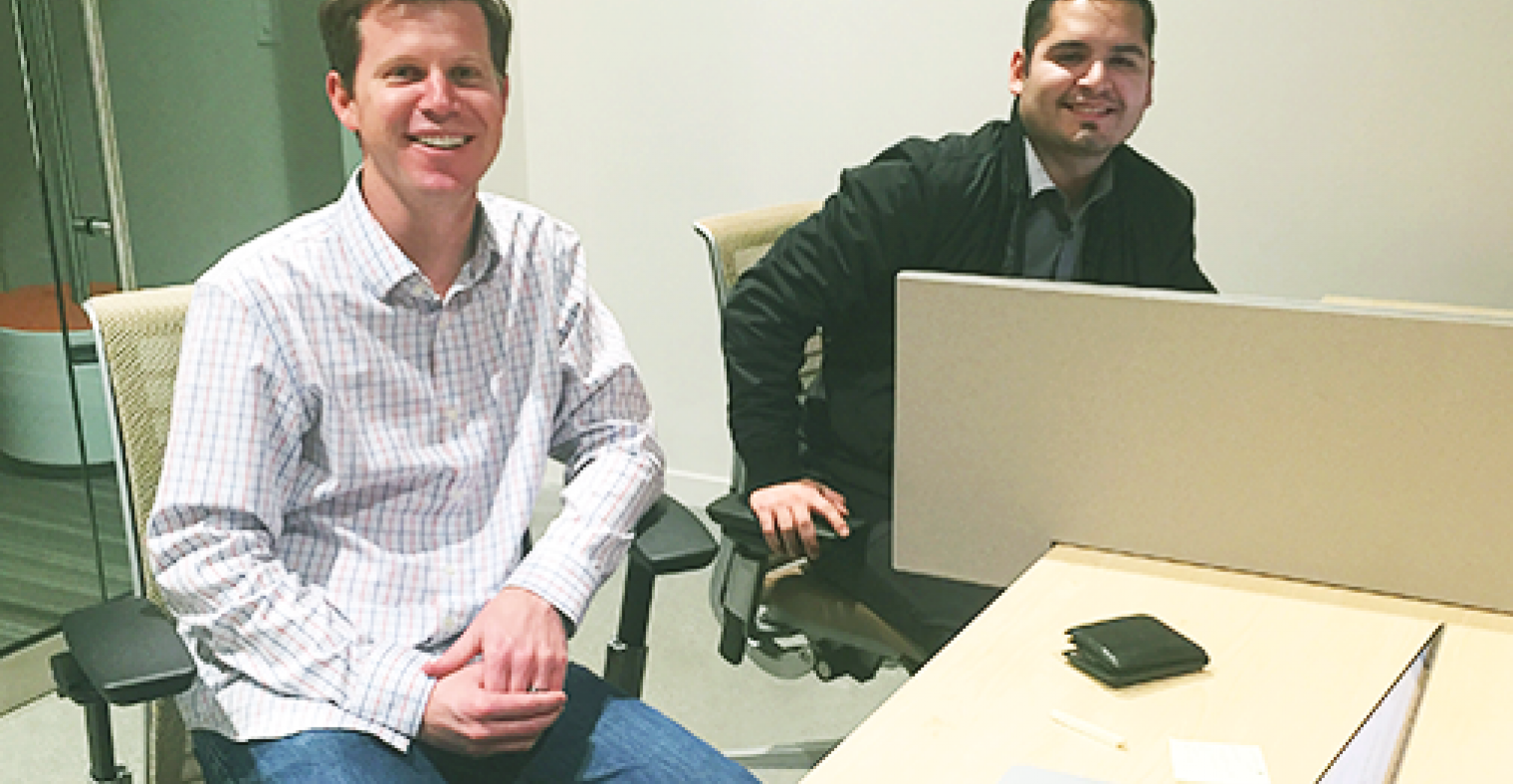Victor & Adam from Specright Inc stop to flash their smiles while working.